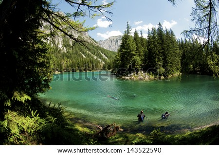 Scuba divers in Green Lake, Austria - stock photo