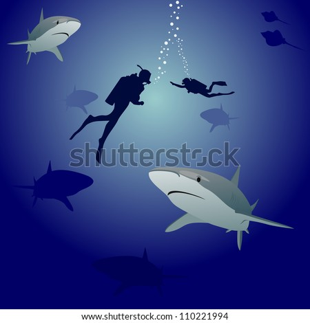 Scuba divers in the sea, surrounded by marine predators-sharks - stock photo