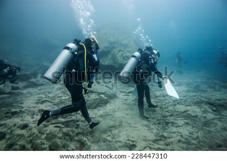 Scuba diving climb the mountain under the hot spring, hot water make vision blurry in Coron area, Palawan, Philippines. - stock photo