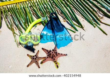 Scuba equipment on the beach - stock photo