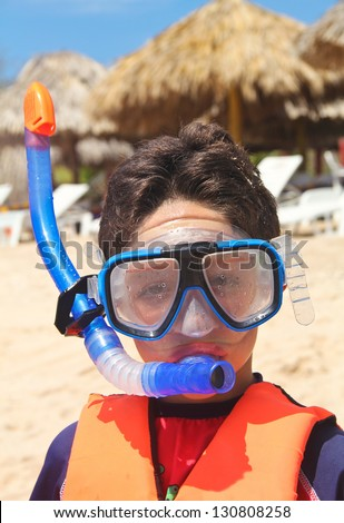 scuba kid in tropical beach - stock photo