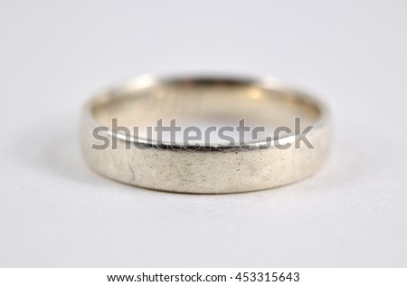 Scuffed and scratched silver ring, isolated