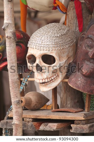 Scull for sale in a market stand among other stuff. - stock photo