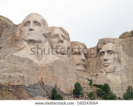 Sculpted images of Presidents George Washington, Thomas Jefferson. Theodore Roosevelt, and Abraham Lincoln at the Mt. Rushmore National Memorial, Keystone, South Dakota - stock photo