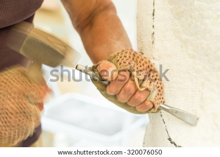 Sculptor hands while working with the tools. Selective focus. Photo can be used as a whole background. - stock photo