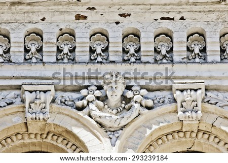 sculptural decoration of the facade of the old house - stock photo