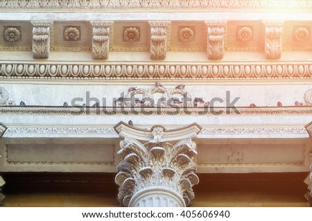 Sculptural details of the Kazan Cathedral colonnade in Saint-Petersburg, Russia with birds sitting on the building under warm soft sunshine - stock photo