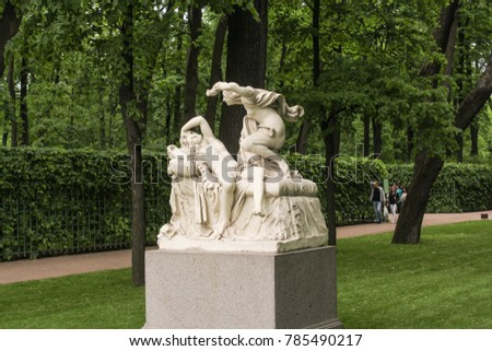 Sculptural group Cupid and Psyche. St. Petersburg, Russia - 18 June, 2017. Walking through the Summer Garden of St. Petersburg in cloudy, rainy weather.