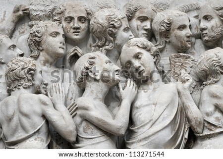 Sculptural group with the image of righteous persons on an external facade of the Cathedral, Orvieto, Italy - stock photo