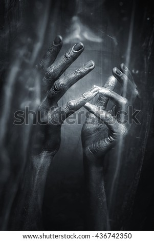 Sculptural Metal male hands on a black background - stock photo