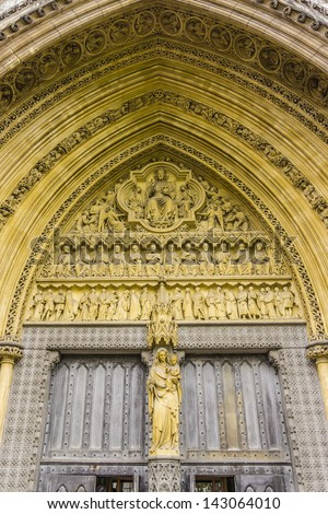 Sculpture above North Entrance of Westminster Abbey (Collegiate Church of St Peter at Westminster) - Gothic church in City of Westminster, London. - stock photo