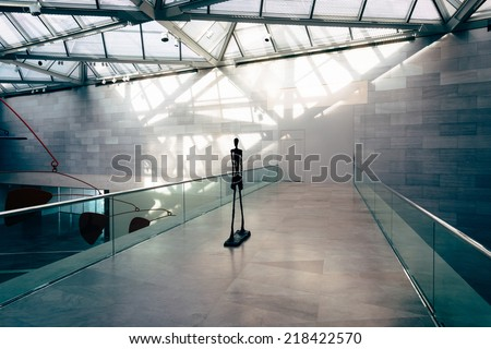 Sculpture and modern architecture in the East Building of the National Gallery of Art, Washington, DC. - stock photo