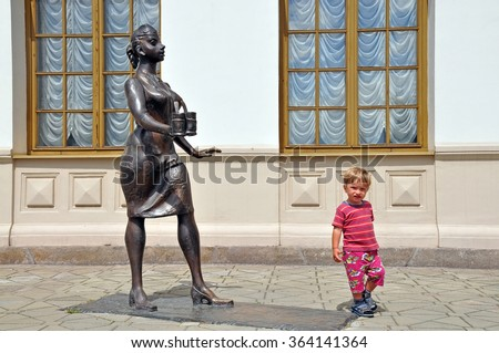 Sculpture conductors and the child, in the historic part of the railway station in Ekaterinburg, Russia