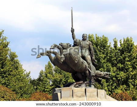 Sculpture depicting a rider and his war horse in a rapid burst of rush at the enemy - stock photo