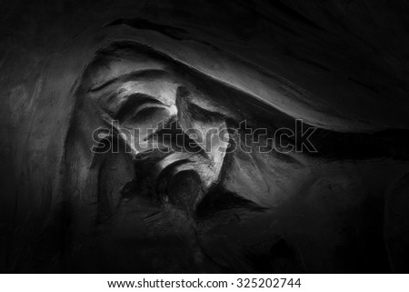 Sculpture depicting Death, in an Italian cemetery. - stock photo
