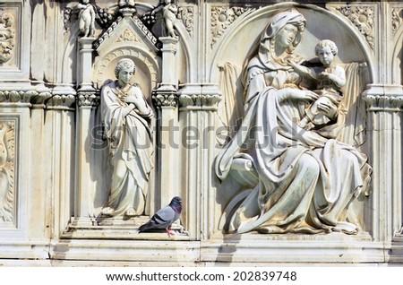 sculpture in fonte gaia, Piazza del Campo, Siena, Tuscany, Italy - stock photo