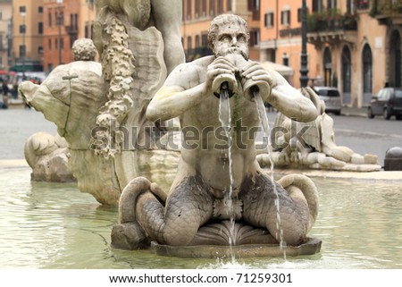 Sculpture in fountain in Rome on the place Navona - stock photo