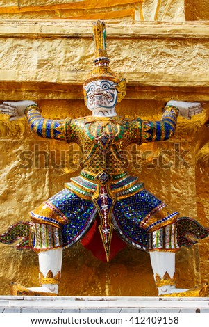 Sculpture in Royal Palace, Bangkok, Thailand. Wat Phra Keo. Architecture detail - statue of mythical creature with green skin. - stock photo