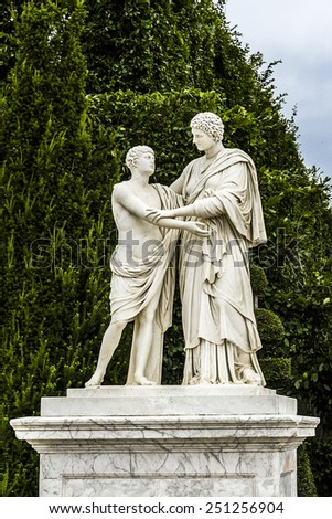 Sculpture in the garden of the Versailles Palace. The Palace Versailles was a royal chateau. It was added to the UNESCO list of World Heritage Sites. Paris, France. - stock photo
