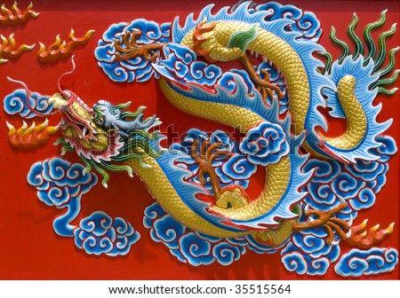 Sculpture in the  temple in Pattaya. Thailand. Chinese dragon. - stock photo