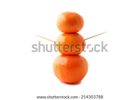 Sculpture made with clementine oranges representing a healthy person. - stock photo