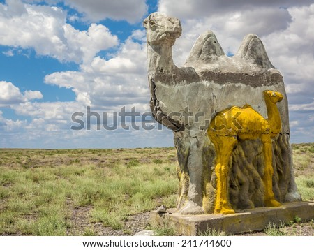 sculpture of a camel in the desert - stock photo