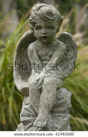 Sculpture of a cherub in Georgetown cemetery, in Washington DC.