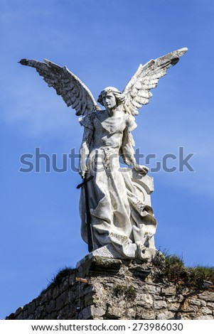Sculpture of a Guardian angel with a sword in the cemetery of Comillas. Cantabria - Spain - stock photo