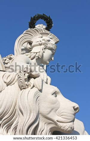 Sculpture of a head of young woman of a greek god Nike and a Lion sculpture in white marble
