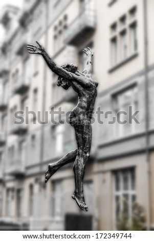 Sculpture of a naked woman on a background of city buildings in black and white. Norway. Bergen - stock photo