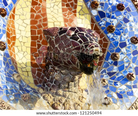 Sculpture of a snake of Antoni Gaudi mosaic in park guell of Barcelona - stock photo