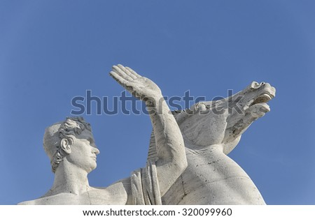 Sculpture of a warrior shelters from the sun - stock photo