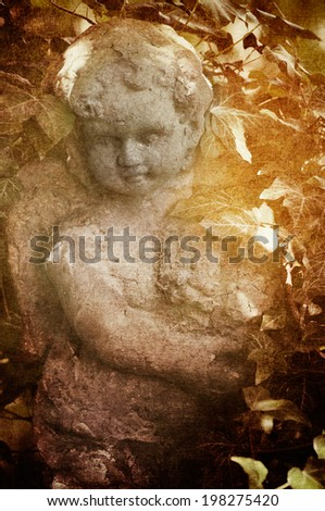 Sculpture of an angel in a mystic garden, textured picture, vintage style - stock photo