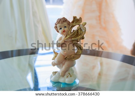 sculpture of an angel. lovely angelic figurine - stock photo