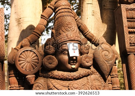 Sculpture of Balaji created through woodern carving