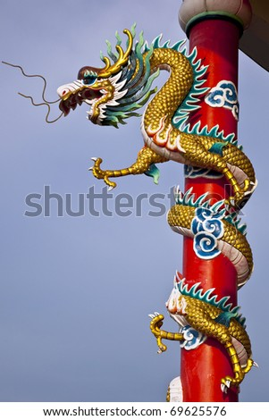 Sculpture of dragon on the red pole.