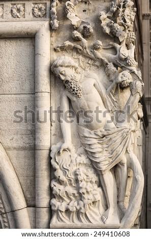 sculpture of drunken Noah on the corner of Doge's palace. Venice. Italy. - stock photo