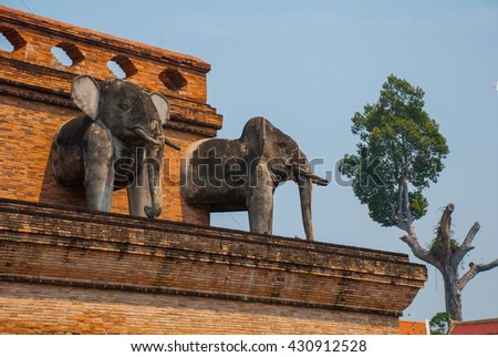 Sculpture of elephants on the stupa in a Buddhist temple. Chiangmai. Thailand