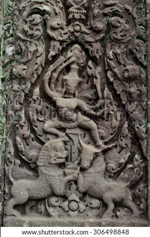 sculpture of god fighting with bull and lion at Banteay Samre - stock photo
