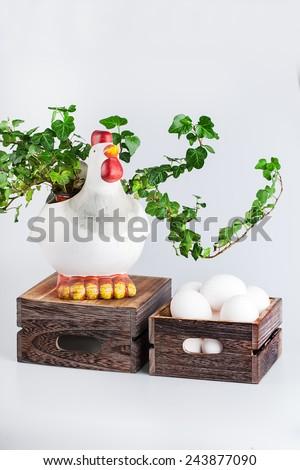 sculpture of hen near  bio eggs in box - stock photo