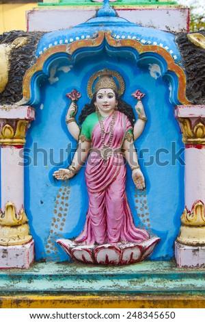 Sculpture of Hindu god. - stock photo