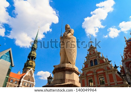 Sculpture of Roland and St. Peter's Cathedral (Town Hall square, Riga, Latvia) - stock photo