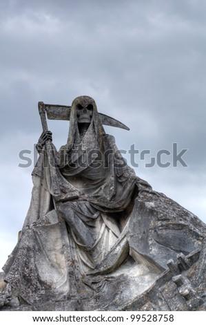 Sculpture of stone grim reaper - stock photo