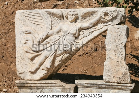 Sculpture of the god Nike in the archaeological site of ancient roman city Ephesus, Turkey - stock photo