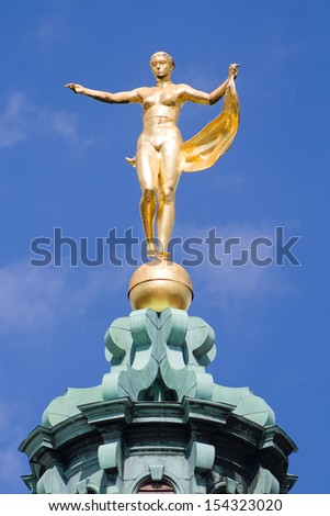Sculpture of the goddess Fortuna on the dome Charlottenburg Palace. Berlin. - stock photo