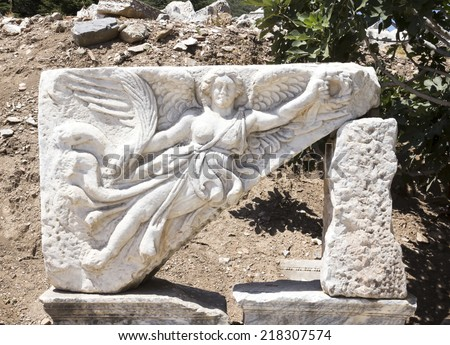 Sculpture of the goddess Nike in the archaeological site of ancient Ephesus, Turkey - stock photo