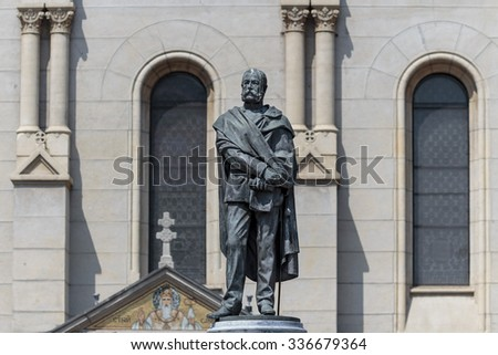 Sculpture of the Petar Preradovic a Croatian poet, writer, and military general in the Austro Hungarian Army. Serbian orthodox church in background