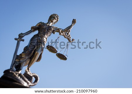 sculpture of themis, femida or justice goddess on bright blue sky copy space background - stock photo