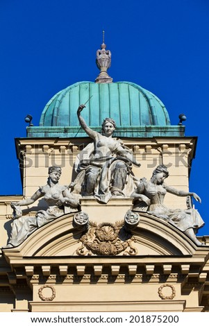 sculpture of three women on facade o juliusz slowacki theater in cracow in poland  - stock photo
