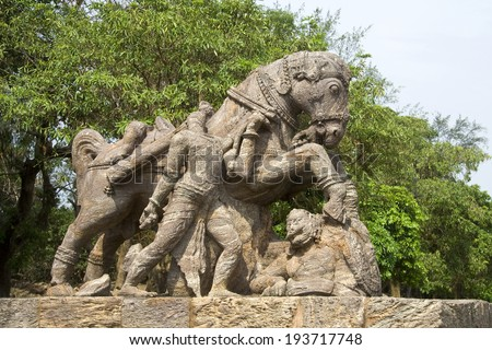 Sculpture of war horse crossing over soldier at Sun Temple, Konark, Orissa, India, Asia
